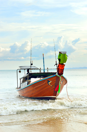 longtail: Longtail boat on a beach
