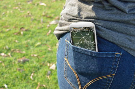 White smart mobile phone in jeans pocket Stock Photo