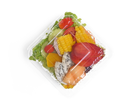 Take away healthy salad in plastic package on white background, top view Stock Photo