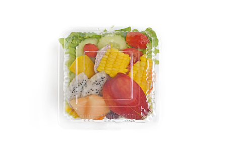 Take away healthy salad in plastic package on white background