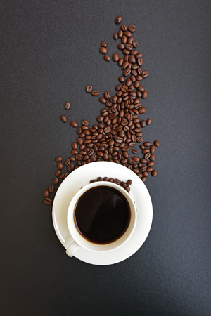 Cup of hot coffee with coffee beans, Dark background Stock Photo