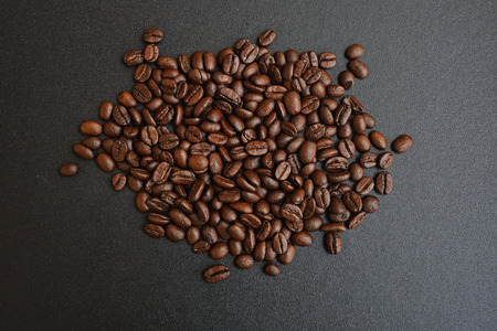 Roasted coffee beans  on dark background Stock Photo