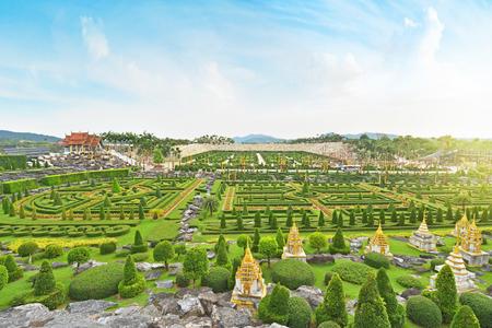 PATTAYA,THAILAND - NOVEMBER 27,2017 : French garden of Nong Nooch Tropical Botanical Gardenat sunrise , Pattaya, Thailand