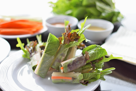 Fresh vegetable salad roll healthy food on white plate