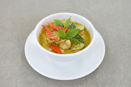 Thai chicken green curry, creamy soup, with eggplant Stock Photo
