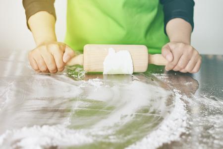 Chef knead dough to prepare food.