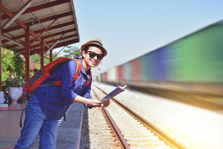 Travelers traveling in the countryside by train Stock Photo