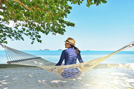 Woman relaxing in the hammock on tropical beach, Samui island Thailand Stock Photo