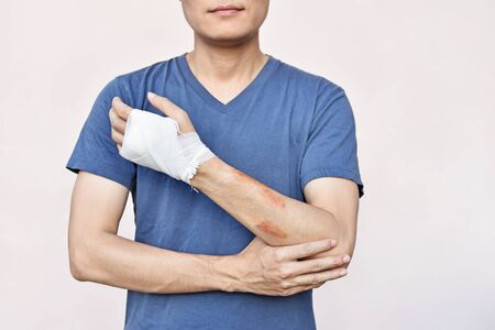 Man with hand in bandage after accident Stock Photo