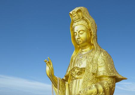 golden quanyin buddhist goddess of mercy statue photo