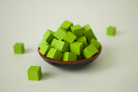 Green cubes arranged in a pile.