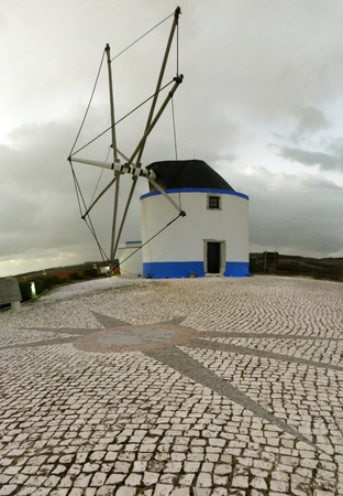 old windmill in Portugal photo