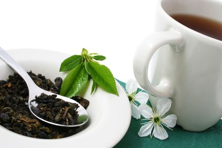 tea cup and dried tea leaves photo
