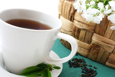 tea cup and dried tea leaves