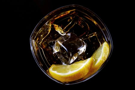 glass of ice and alcohol