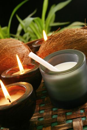 Still Live with coconut and candle photo