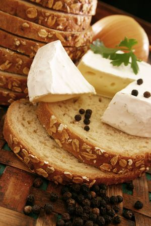 Bread and cheese on wooden board