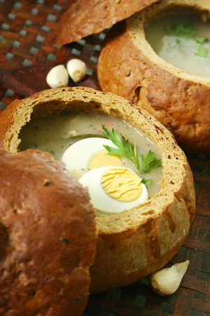 epicurean: Traditional Polish soup made from fermented rye, served in bread .