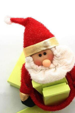 Christmas santa puppet with green presents photo