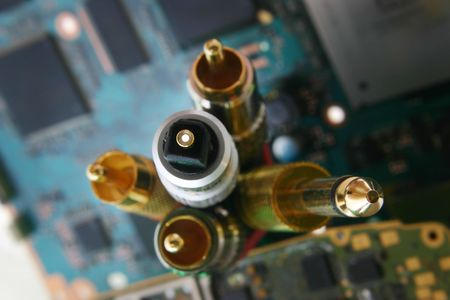 techie: bunch of wires and cables. Fiber optic cable connector in focus Stock Photo