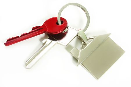 view of two keys with silver house figure on the white
