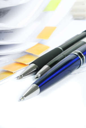 Signing a contract. Focus is on the end of the pen. Stock Photo