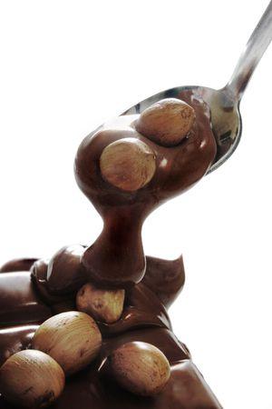 Milk chocolate with hazelnut over white background Stock Photo