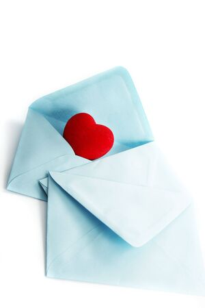 envelope with a heart on a white background photo