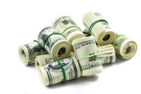 rolls of money held by a rubberband on white background