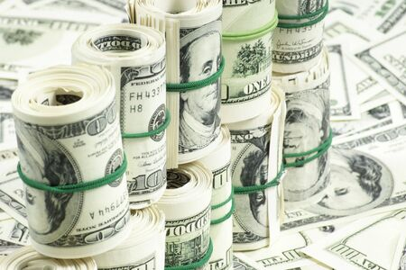 rubberband: rolls of money held by a rubberband  Stock Photo
