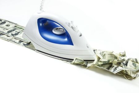 household money: Process of ironing of a bunch of US dollar bills