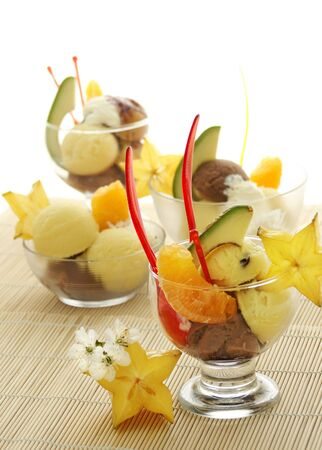 ice cream with fresh fruits in a bowl close up