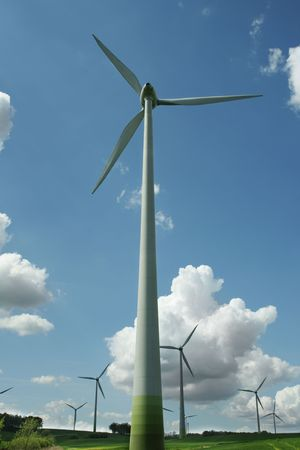 energy concept - wind turbines in beautiful summer landscape, amazing cloudscape photo