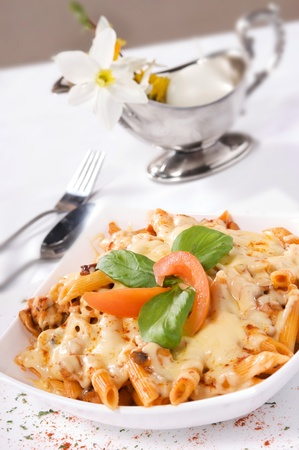 Creamy Baked Chicken served with pasta and cheese sauce.