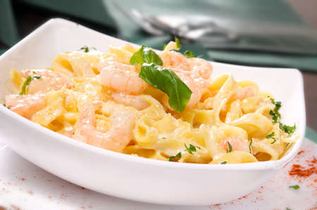 Prepared Shrimp with linguine noodles and creamy garlic sauce on top green basil spring  Selective focus  Stock Photo