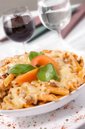 Creamy Baked Chicken served with pasta and cheese sauce