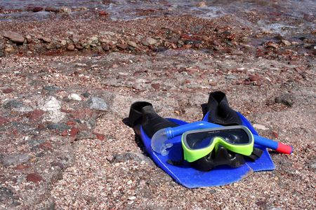 snorkle: snorkle, fins, and mask on beach