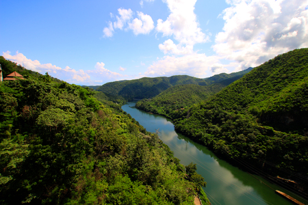 The river flows from the dam in Thailand. Stock Photo