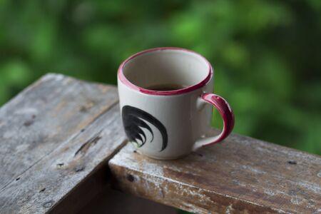 Coffee mug with green background Stock Photo