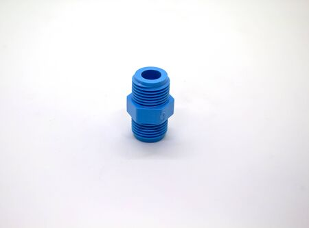 Plastic joints for water pipes on a white background, spare equipment