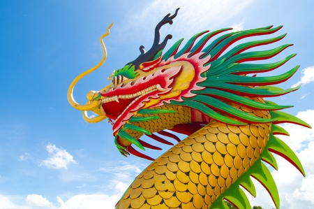 Chinese style dragon statue on blue background.