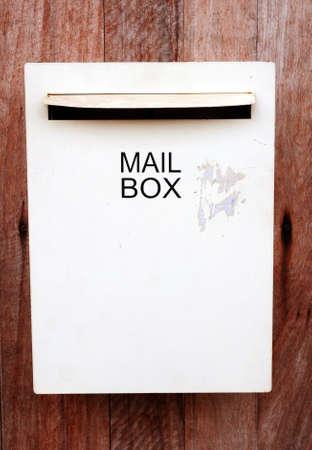 Mail box on wood background  Stock Photo
