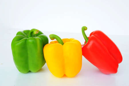 Red Green Yellow sweet pepper paprika isolated on white background