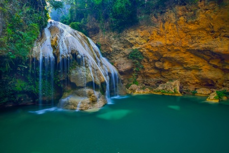 Beautiful waterfall with green water  photo