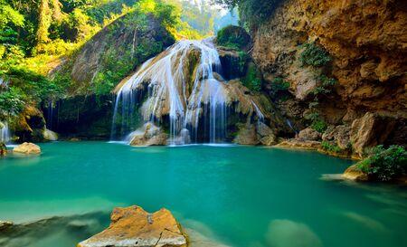 Beautiful waterfall with green water
