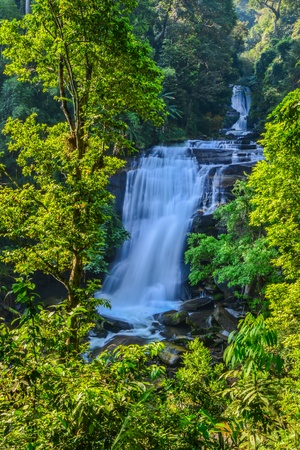 Waterfall in spring season located in deep rain forest jungle  photo