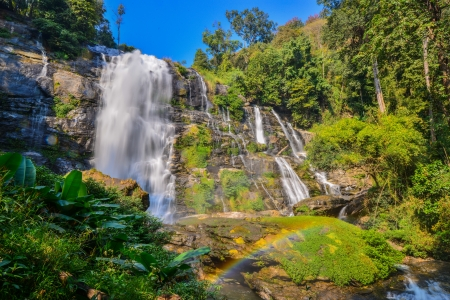 Waterfall in spring season located in deep rain forest jungle