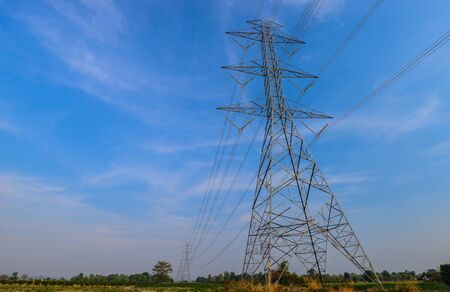 The electric power line transmission tower on blue sky