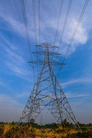 isolator: The electric power line transmission tower on blue sky