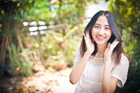 Beautiful asian with welcome expression,